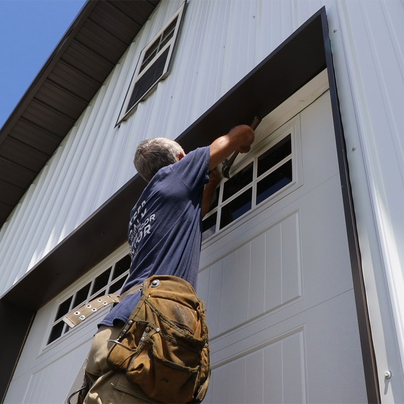 Pro Door Doctor Installing new garage door.